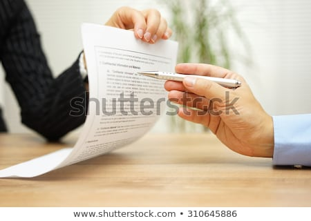 lawyer reading legal contract agreement disclaimer with magnifyi stock photo © stevanovicigor