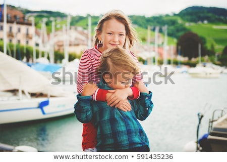 brother and sister on a beautiful lake stock photo © zurijeta