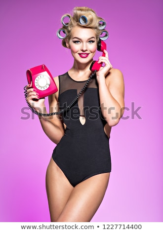 pin up girl in red swimsuit talking on the phone stock photo © deandrobot