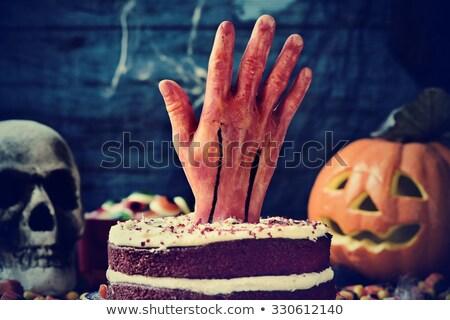 Gâteau sanglante main effrayant scène halloween Photo stock © nito