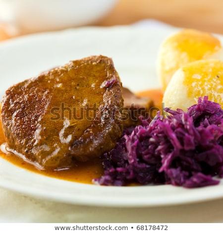 roast pork potato dumplings and red cabbage stock photo © digifoodstock