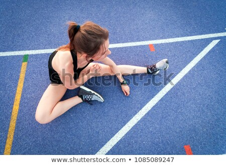 fitness young woman resting on running track stock photo © deandrobot