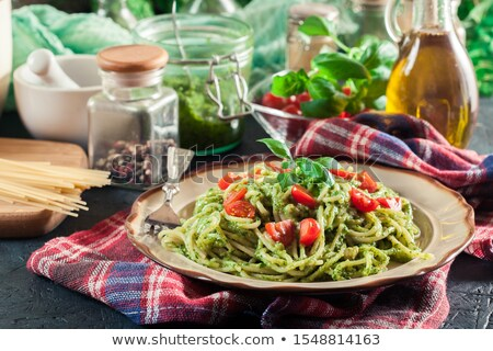 pasta with basil pesto and pine nuts cherry tomatoes stock photo © peteer
