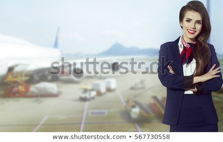 Young beautiful air hostess smiles Stock photo © Aikon