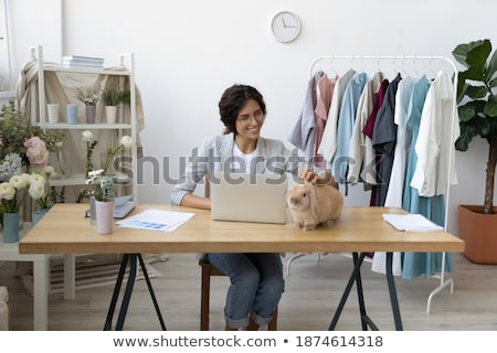 Female tailor having rest in workshop Stock photo © dash
