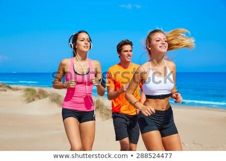 笑みを浮かべて スポーティー ブロンド ジョギング ヘッドホン 女性 ストックフォト © wavebreak_media