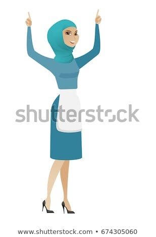 Young muslim cleaner standing with raised arms up. Stock photo © RAStudio