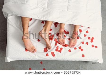 привязчивый · пару · целоваться · кровать · семьи · домой - Сток-фото © foremniakowski