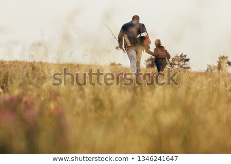Boy & father walking shot from low angle Stock photo © IS2