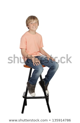 Ragazzo seduta sgabello cielo erba bambino Foto d'archivio © IS2