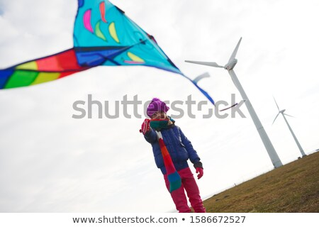 Girl Flying Kite at Wind Turbines Stock photo © IS2