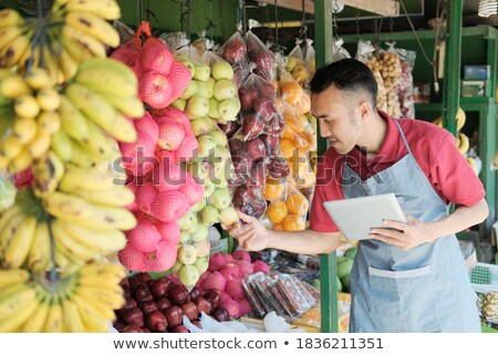 Boy observing an apple. Stock photo © IS2