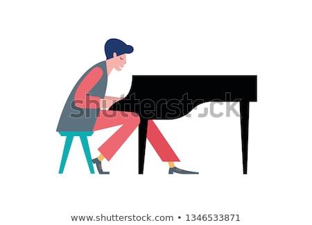 Stock photo: businessman playing piano