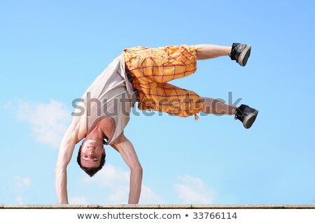 young guy dances a break dans on a beach stock photo © massonforstock