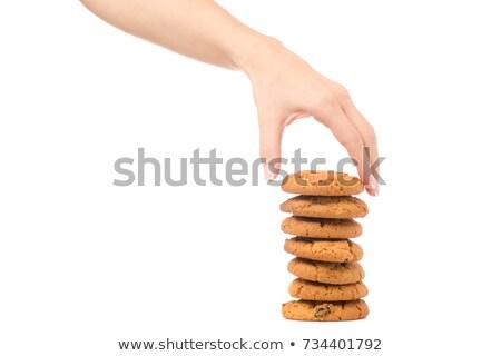 Női kéz tart szín csokoládé cukorkák Stock fotó © DenisMArt