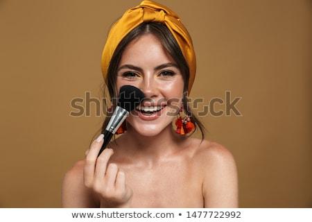 Gyönyörű lány tart sminkecset alap por fehér Stock fotó © DenisMArt