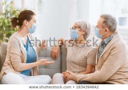 mother and daughter wearing masks stock photo © is2