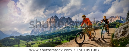 Mountain biking women riding on bike in summer landscape Stock photo © lightpoet