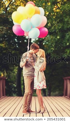 uśmiechnięty · człowiek · całując · uśmiechnięta · kobieta · kobieta - zdjęcia stock © is2