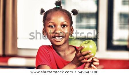 A teacher holding an apple Stock photo © IS2