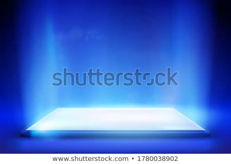 Laptop on light blue background Stock photo © stokkete