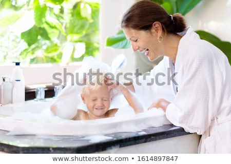 Little girl taking a bath Stock photo © IS2