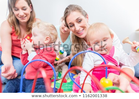 group of happy young mothers watching their cute and healthy babies stock photo © kzenon