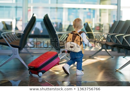 Happy mother with little boy travelling in backpack Stock photo © blasbike