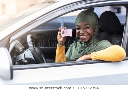Woman Sitting Inside Car Showing Driving License Stock photo © AndreyPopov
