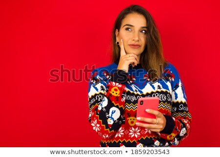 Frowning Hispanic Girl On Cell Phone Stock photo © feverpitch