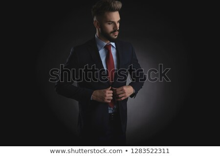 portrait of curious smart casual man in navy suit  Stock photo © feedough