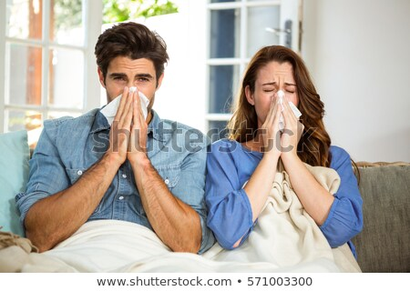 Sick Couple Sneezing In Tissue Stock photo © AndreyPopov