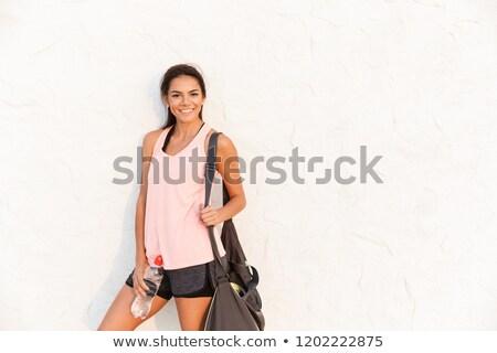 Fotó sportos nő sportruha sportos táska Stock fotó © deandrobot