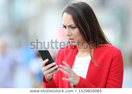 Triste desesperado nina mujer malas noticias teléfono celular Foto stock © diego_cervo