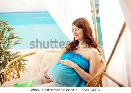 Gyönyörű terhes nő tengerpart bungaló lány arc Stock fotó © ElenaBatkova