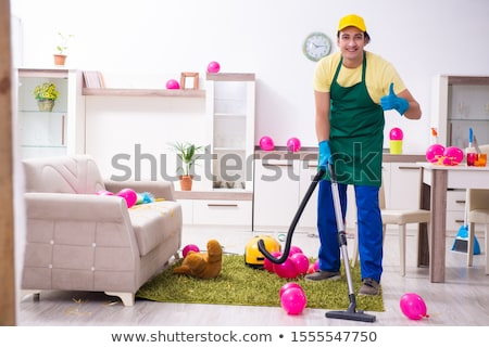 Young male contractor doing housework after party  Stock photo © Elnur