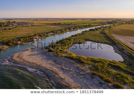 Huts of fishermen in the sunset Stock photo © tilo
