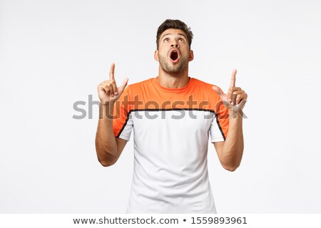 Guy drop jaw from amazement, see stunning great product on top advertising. Masculine handsome man i Stock photo © benzoix