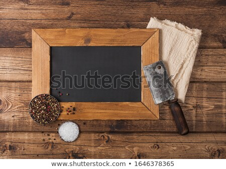 Vintage hatchet for meat with menu display board with salt and pepper on wooden table background. Sp Stock photo © DenisMArt