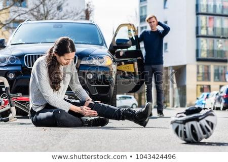 Młoda kobieta w dół szkoda rower wypadku ulicy Zdjęcia stock © Kzenon