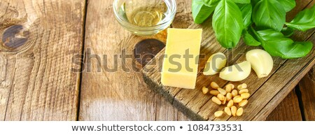 Banner of Homemade pesto sauce in glass jar with ingredients. Stock photo © Illia