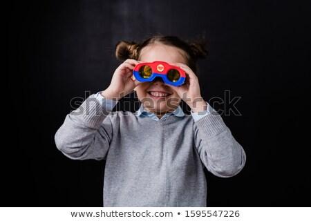 Aranyos mosolyog kislány néz látcső kamera Stock fotó © pressmaster