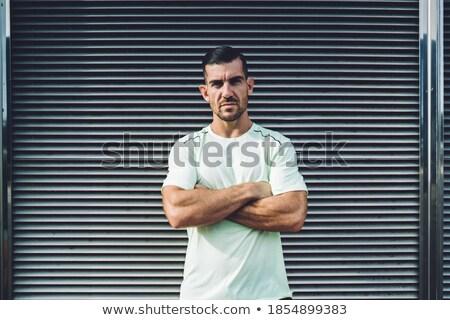 half Serious young man posing cross hands Stock photo © Paha_L