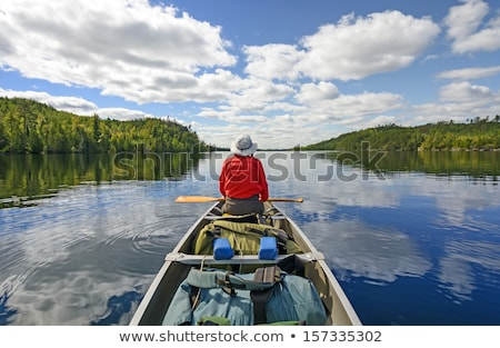 Canoeist on Wilderness Lake Stock photo © mackflix