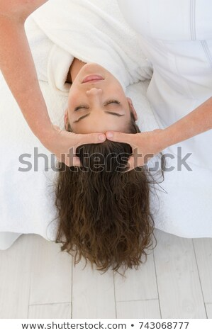 Woman being given a head massage. Stock photo © photography33