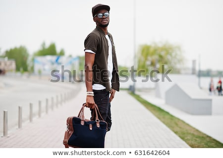 young black man in leather stock photo © curaphotography