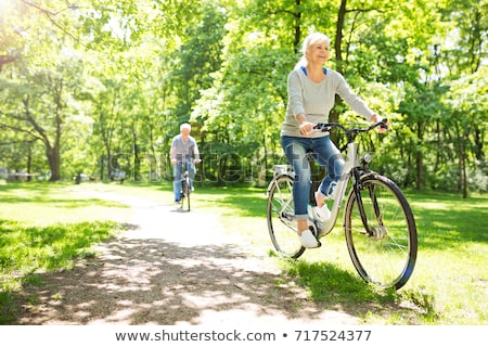 senior men and women riding bicycles Stock photo © photography33