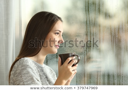 portrait of beautiful girl in wet window stock photo © utorro