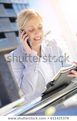 Blond businesswoman speaking on the phone Stock photo © photography33