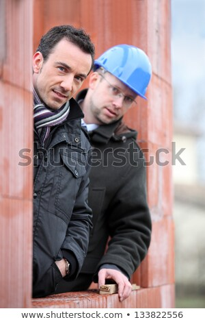 Two site workers hiding in unfinished house Stock photo © photography33